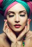 Beautiful lady with colored turban Royalty Free Stock Images