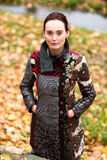 Beautiful lady in colorful coat poses in autumn Stock Photography