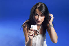 Beautiful lady with condom stock photography