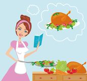 Beautiful lady with cookbook Royalty Free Stock Image