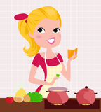 Beautiful lady cooking Royalty Free Stock Photos