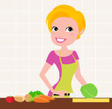 Beautiful lady cooking Royalty Free Stock Photography