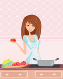 Beautiful lady cooking soup Royalty Free Stock Image