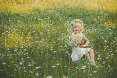Beautiful lady with cute daughter on camomile field Royalty Free Stock Images