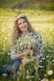 Beautiful lady with cute daughter on camomile field Royalty Free Stock Image