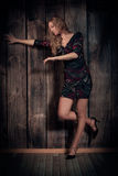 Beautiful lady dancing over wooden wall background Royalty Free Stock Photo