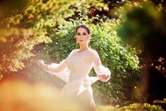 Beautiful lady dancing in sunlight garden royalty free stock photos