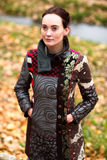 Beautiful lady in design coat poses in autumn Stock Photo