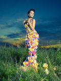 Beautiful lady in dress of flowers Stock Image