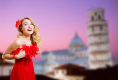 Beautiful lady in dress happy smiling beside Stock Photos