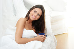 Beautiful lady is drinking coffee. At bed Stock Images