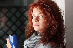 Beautiful lady is drinking coffee Stock Photo