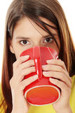 Beautiful lady is drinking coffee Royalty Free Stock Photography