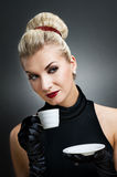 Beautiful lady drinking coffee. Retro portrait Royalty Free Stock Images