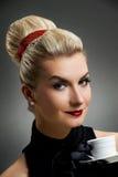 Beautiful lady drinking coffee. Retro portrait Stock Photo