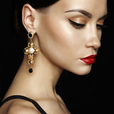 Beautiful lady with earring on black background Royalty Free Stock Photo
