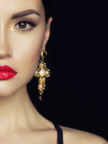 Beautiful lady with earring on black background Stock Photo