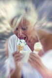 Beautiful lady eating ice cream sitting on a deckchair royalty free stock images