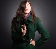 Beautiful lady in an elegant coat Stock Images