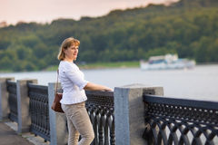 Beautiful lady enjoying the river view in the city center Stock Images