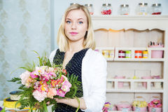 Beautiful lady with flower boquet Royalty Free Stock Images
