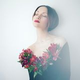 Beautiful lady with flowers Royalty Free Stock Photography