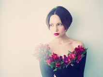 Beautiful lady with flowers Royalty Free Stock Images