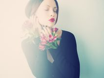 Beautiful lady with flowers Stock Images