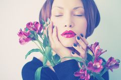 Beautiful lady with flowers Royalty Free Stock Image