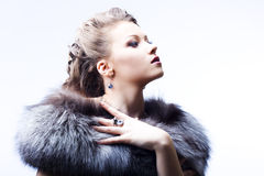 Beautiful lady in fur Stock Photography
