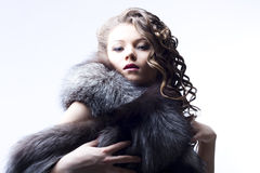 Beautiful lady in fur Stock Photos