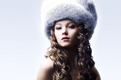 Beautiful lady in fur cap Stock Image
