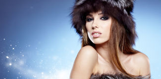 Beautiful lady in fur cap Royalty Free Stock Photography