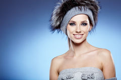 Beautiful lady in fur cap Royalty Free Stock Image
