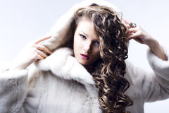 Beautiful lady in fur coat Royalty Free Stock Photography