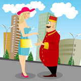 Beautiful lady giving key to bellboy Royalty Free Stock Photography