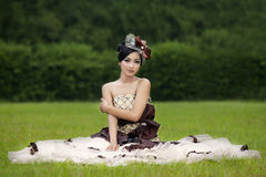 Beautiful lady in gown on green field Royalty Free Stock Photos