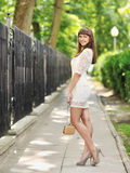 Beautiful lady in a green park in summer Stock Image