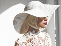 Beautiful lady in hat. Outdoor fashion photo of young beautiful lady in white hat. Summer Beach travel. Summer vibes Stock Photography
