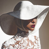 Beautiful lady in hat and sunglasses. Outdoor fashion photo of young beautiful lady in hat and sunglasses. Summer Beach travel. Summer vibes Royalty Free Stock Photo