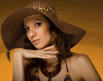 Beautiful lady in hat and swimsuit Royalty Free Stock Photography