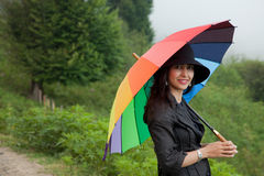 Beautiful Lady with Hat and Umbrella Royalty Free Stock Image