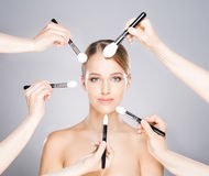 Beautiful lady is having a procedure of applying make-up Stock Photography