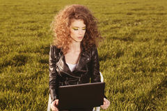 Beautiful lady with her laptop on grass Royalty Free Stock Image