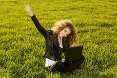Beautiful lady with her laptop on grass Royalty Free Stock Photos