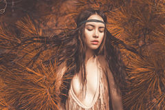 Beautiful lady hippie in fir forest Stock Photos