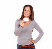 Beautiful lady holding card smiling at you Royalty Free Stock Image