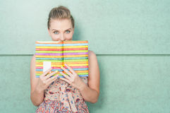 Beautiful lady holding diary and covering her mouth Royalty Free Stock Photo