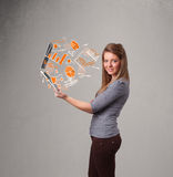 Beautiful lady holding notebook with graphs and statistics Royalty Free Stock Image