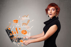 Beautiful lady holding notebook with graphs and statistics Stock Images